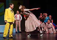 """Nehemiah Monon-Marquis (Conrad Birdie) with Brenna O'Connor (Kim MacAfee) as she prepares for """"One Last Kiss"""" during dress rehearsal for Bye Bye Birdie with Gilford Middle School Tuesday afternoon.  (Karen Bobotas/for the Laconia Daily Sun)"""