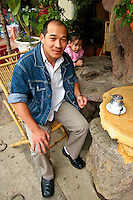 """The 100 Roofs Cafe, designed by a friend and colleague of the """"Crazy House"""" in Dalat, the cafe, with its labyrinthe of caves, passageways, murals, masks and other paraphernalia is an ongoing work of art. In some of the newer rooms, the cement is still drying.  The cafe even manages to serve tea and snacks."""