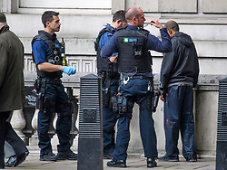 © Licensed to London News Pictures. 16/09/2017. London, UK. Armed police perform a stop and search on a man on Whitehall, Westminster, London, the day after a bomb partly exploded on a tube train at Parsons Green station in London injuring members of the public. Operation temperer has been put in to place after the UK terror threat level was raised to critical. Photo credit: Ben Cawthra/LNP