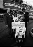 5,000,000th Passenger Through Dublin Airport. (T12).1989..22.12.1989..12.22.1989..22nd December 1989..The date,Friday,22nd December 1989 will be remembered as an historic day in Irish Aviation as Aer Rianta celebrated the 5millionth passenger to fly through Dublin Airport in one year. The Lucky passenger, Nicola Wynne, arrived at 10AM from Germany and was welcomed to Dublin Airport by General Manager,Tom Cullen...Pictured on the arrivals ramp at Dublin Airport were, Mr Tom Cullen,General Manager,Aer Rianta; Nicola Wynne; her mother,Mrs Marie Wynne and Mr Terence McGowan, Manager Airport Services, Delta Airlines. Nicola, the 5millionth passenger through the airport, had travelled home from Germany for the Christmas period.