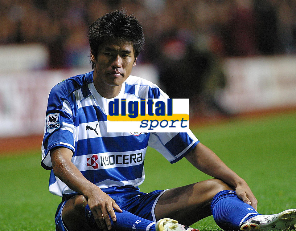 Photo: Dave Linney.<br />Aston Villa v Reading. The Barclays Premiership. 23/08/2006.Reading's Seol Ki-Hyeon takes a breather after being brought down in the box.