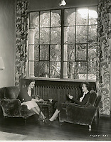 1935 Gail Patrick (left) and Wendy Barrie chat in the living room at the Hollywood Studio Club on Lodi Pl.