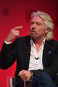 Institute of Directors Annual Conference 2013.<br /> Sir Richard Branson speaking on stage at the IoD Annual Convention.
