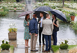 The Duke and Duchess of Cambridge and Prince Harry visit the White Garden in Kensington Palace, London, as they meet with representatives from charities supported by Diana, the Princess of Wales.