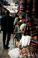 Morocco, Marrakesh. Muslim man solving the Rubik's Cube in the souk.