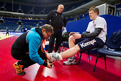 Physiotherapist Gorazd Zuzek with Matej Gaber of Slovenia, who has twisted his ankle during practice session of Slovenia team 1day before handball match against Macedonia for 5th place at 10th EHF European Handball Championship Serbia 2012, on January 26, 2012 in Beogradska Arena, Belgrade, Serbia.  (Photo By Vid Ponikvar / Sportida.com)