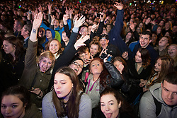 © Licensed to London News Pictures . 07/11/2015 . Manchester , UK . Crowd in front of the stage for the Christmas Lights switch on at Albert Square in front of Manchester Town Hall . Photo credit : Joel Goodman/LNP