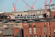 Build Bridges not walls . Demonstrators hang a banner which reads  'What happens next is up to us from the Millenium footbridge as a protest against the inauguration of Donald Trump as US President,  January 20th 2017.