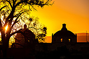 Colorful sunset over the domes of San Francisco church in the historic city center in San Miguel de Allende, Mexico.