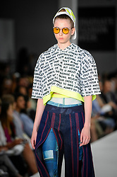 © Licensed to London News Pictures. 03/06/2018. LONDON, UK.  A model presents a look by Emily Hayward from Plymouth College of Art on the opening day of Graduate Fashion Week taking place at the Old Truman Brewery in East London.  The event presents the graduation show of up and coming fashion designers from UK and international universities.  Photo credit: Stephen Chung/LNP