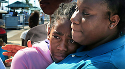 A child from the Freeport Children's Home orphanage, who was evacuated from Freeport, Bahamas, aboard Royal Caribbean's Mariner of the Seas cruise ship, cries as she arrives in Nassau on Saturday, Sept. 7, 2019. Photo by Joe Burbank/Orlando Sentinel/TNS/ABACAPRESS.COM