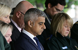 Mayor of London Sadiq Khan joins London Ambulance workers in observing a minute's silence at London Ambulance Service HQ at Waterloo in honour of the London Bridge terror attack victims.