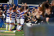 Queens Park Rangers players celebrate a goal from Queens Park Rangers forward Conor Washington (9) (score 1-0) during the EFL Sky Bet Championship match between Queens Park Rangers and Nottingham Forest at the Loftus Road Stadium, London, England on 29 April 2017. Photo by Andy Walter.