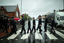 © Licensed to London News Pictures . 15/07/2016 . Bolton , UK . Police officers crossing the street opposite the church , following the service . The funeral of Special Constable Samantha Derbyshire at St Mary's RC Church in Horwich , Bolton. Derbyshire was struck and killed by an HGV on the M61 motorway following a collision , in the early hours of Monday 11th July 2016 . Photo credit : Joel Goodman/LNP