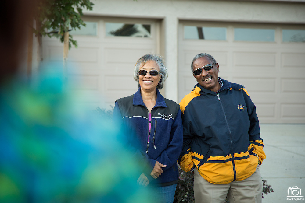 Nell and James Bradley laugh after introducing themselves as 26-year-residents during the Princess Place National Night Out party in Milpitas, California, on August 8, 2013. (Stan Olszewski/SOSKIphoto)