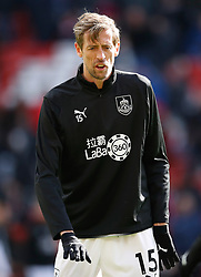 Burnley's Peter Crouch warming up before the game