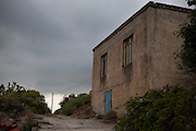 Old house on a path the ancient town of Polyrinia, in Hania province, Crete, Greece