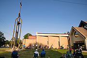 23 AUGUST 2020 - WEST DES MOINES, IOWA: People sit on the lawn during a memorial service for the victims of COVID-19 at West Des Moines United Methodist Church. More than 100 people attended the service at the church for Iowans who have died from COVID-19. Iowa is one of the Midwestern states that has recorded an increasing number of COVID-19 infections. Since Friday, August 21, Iowa has recorded 1,448 new cases of COVID-19. More than 1,030 Iowans have died from COVID-19, the disease caused by the Novel Coronavirus (SARS-CoV-2) since the pandemic hit Iowa in March.         PHOTO BY JACK KURTZ