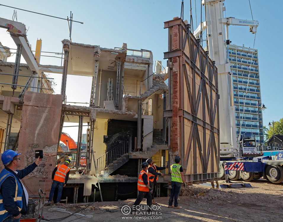 London, United Kingdom - 20 September 2019<br /> EXCLUSIVE SET - Aerial construction specialists and demolition experts use a huge crane to carefully lift intact, a twenty five ton, two-story wall, to preserve a famous Banksy rat image which has been covered up for years. Teams from specialist companies have spent over six weeks cutting around the artwork and fitting custom made eight ton steel supports to enable them to save the historic piece of art. Work has started on the construction of a new twenty seven floor art'otel hotel on the site of the old Foundry building in Shoreditch, east London, and a condition of the planning permission was to preserve the historical Banksy graffiti. A second section of the painting, an image of a TV being thrown through a broken window has already been cut out and moved separately. After the hotel construction is complete the two parts of the Banksy painting will be displayed on the hotel. Our pictures show the stages of work to protect the image, culminating in the lifting of the three story wall by crane. Video footage also available.<br /> (photo by: EQUINOXFEATURES.COM)<br /> Picture Data:<br /> Photographer: Equinox Features<br /> Copyright: ©2019 Equinox Licensing Ltd. +443700 780000<br /> Contact: Equinox Features<br /> Date Taken: 20190920<br /> Time Taken: 17105098<br /> www.newspics.com