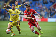 Aron Gunnarsson of Cardiff city (17) holds off Sheff Wed'sChris Maguire.  Skybet football league championship match, Cardiff city v Sheffield Wed at the Cardiff city stadium in Cardiff, South Wales on Saturday 27th Sept 2014<br /> pic by Andrew Orchard, Andrew Orchard sports photography.