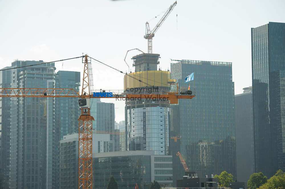 2017 SEPTEMBER 22 - Construction crane and construction work  in South Lake Union, Seattle, WA, USA. In the background, the McKenzie Tower can be seen under construction. By Richard Walker