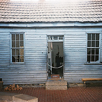 """1. When was this photo taken?<br /> <br /> Around 2010 or 2011<br /> <br /> 2. Where was this photo taken?<br /> <br /> In Missouri, at Mark Twain's birthplace<br /> <br /> 3. Who took this photo? <br /> <br /> Jennifer L. Fandel<br /> <br /> 4. What are we looking at here?<br /> <br /> This is Mark Twain's cabin where he was born and lived until his family moved to Hannibal.<br /> <br /> 5. How does this old photo make you feel?<br /> <br /> So happy! The photo was taken on a crazy camping trip where just about everything went wrong--the first campground was full, the second campground that we drove a distance to find was underwater! We """"camped"""" the first night at a hotel and ate our beans and wieners outside. We had a great weekend.<br /> <br /> 6. Is this what you expected to see?<br /> <br /> I had no expectations. I couldn't remember where the roll of film was from and why it wasn't developed.<br /> <br /> 7. Does this photo bring back any memories?<br /> <br /> My husband and I just moved back to Wisconsin (our home state) after being away for 20 years. We left St. Louis, Missouri, and we're feeling both excited and wistful about the transition. Seeing a reminder of our time in Missouri--especially involving someone so important to the state--is really cool.<br /> <br /> 8. How do you think others will respond to this photo?<br /> <br /> I think they'll be surprised if they read about the photo. I know that a lot of families venture to Hannibal, but I'm not sure if many people know where Mark Twain was born. The cabin is in a historical site (inside), and the town (I believe it's called Florida) doesn't have much going on anymore."""