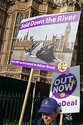 On the day that the UK was scheduled to leave the European Union and political parties commence campaigning for the General Election on December 12th, a Brexiter walks past Westminster Abbey as others voice their anger outside the British parliament in Westminster, on 31st October 2019, in London, England.