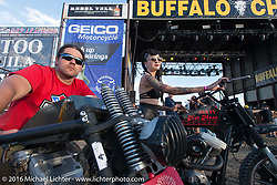 Brad Gregory and Kissa Von Addams take a brake from riding as they stopped in front of the main stage at the Buffalo Chip during the annual Sturgis Black Hills Motorcycle Rally. SD, USA. August 10, 2016. Photography ©2016 Michael Lichter.