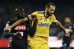 December 1, 2017 - Naples, Italy - Kalidou Koulibaly of Napoli and Giorgio Chiellini of Juventus during the Serie A match between SSC Napoli and Juventus at Stadio San Paolo on December 1, 2017 in Naples, Italy. (Credit Image: © Matteo Ciambelli/NurPhoto via ZUMA Press)