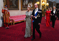 Kellyanne Conway and The Duke of Kent arrive through the East Gallery during the State Banquet at Buckingham Palace, London, on day one of the US President's three day state visit to the UK.