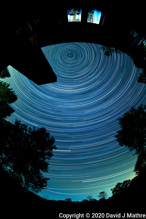 Star Trails looking Up from my backyard patio. Composite of  172 images taken with a Nikon D810a camera and 8-15 mm fisheye lens (ISO 200, 11 mm, f/4, 120 seconds). RAW images processed with Capture One Pro and PhotoShop CC (scripts, statistics, maximum).