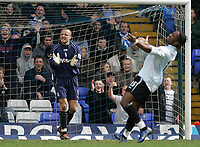 Photo: Lee Earle.<br /> Birmingham City v Chelsea. The Barclays Premiership. 01/04/2006. Chelsea's Didier Drogba (R) looks gutted after failing to score as City keeper Maik Taylor shouts to the defence.