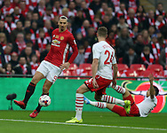 Zlatan Ibrahimovic of Manchester Utd goes past Jack Stephens of Southampton (24). EFL Cup Final 2017, Manchester Utd v Southampton at Wembley Stadium in London on Sunday 26th February 2017. pic by Andrew Orchard, Andrew Orchard sports photography.