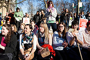 Demonstrators listen to speeches outside Parliament in the warm spring sun. 20.000 people turned out to the Time to Act  climate demonstration. The demonstration calls for urgent action on climate change and solidarity amongst climate change organisations and social justice groups. The March went peacefully through London to the Houses of Parliament.