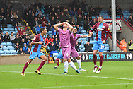 Scunthorpe United defender Charlie Goode (20) scores goal to go 3-1,Rochdale defender Harrison McGahey (6) in despair during the EFL Sky Bet League 1 match between Scunthorpe United and Rochdale at Glanford Park, Scunthorpe, England on 8 September 2018. Photo Ian Lyall