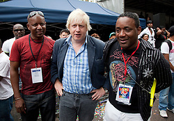 © Licensed to London News Pictures. 29/08/2011. London, UK.  Boris Johnson with Notting Hill Carinval Director Ancil Barclay, left, and Chris Boothman, right. London Mayor Boris Johnson visits the Notting Hill Carnival on Bank Holiday Monday and is greeted enthusiastically by Londoners and Carnivalists alike. Photo credit: Bettina Strenske/LNP
