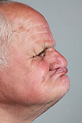 side view portrait of an elderly man without teeth