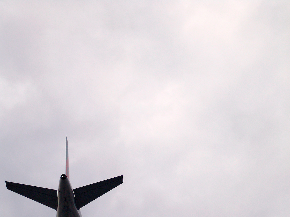 The tail of a commercial airplane in flight.