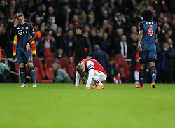 Arsenal's Jack Wilshere cuts a dejected figure on the final whistle - Photo mandatory by-line: Joe Meredith/JMP - Tel: Mobile: 07966 386802 19/02/2014 - SPORT - FOOTBALL - London - Emirates Stadium - Arsenal v Bayern Munich - Champions League - Last 16 - First Leg
