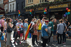 Portland Place, London, June 25th 2016. Thousands of LGBT people and their supporters gather for Pride in London, a colourful celebration of the hard-won rights of lesbian, gay, bisexual and transgender  people. PICTURED: Revellers gathered outside a pub in Soho.