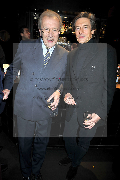 """Left to right, SIR DAVID FROST and NIGEL HAVERS at a party to promote the """"American Songbook in London"""" aseries of intimate concerts featuring 1959 Broadway songs, held at Pizza on The Park, Hyde Park Corner, London on 18th March 2009."""