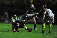 Toby Faletau © of the Dragons is tackled by Kahn Fotuali'i of the Ospreys. .Rabodirect Pro12 rugby match, Newport Gwent Dragons v Ospreys at Rodney Parade in Newport, South Wales on New Years Eve, Monday 31st Dec 2012. pic by Andrew Orchard, Andrew Orchard sports photography,