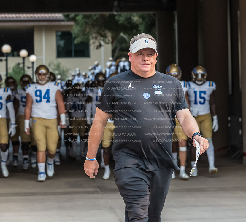PALO ALTO, CA - SEPTEMBER 26:  Head coach Chip Kelly of the UCLA Bruins enters the stadium during an NCAA Pac-12 college football game against the Stanford Cardinal on September 26, 2021 at Stanford Stadium in Palo Alto, California.  (Photo by David Madison/Getty Images)