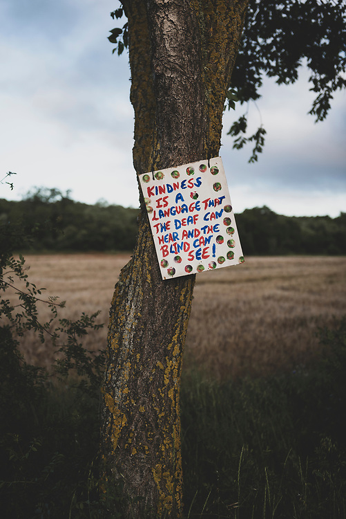A sign hangs from a tree on the Camino outside the village of Calzadilla de la Cueza. It reads: Kindness is a language that the deaf can hear and the blind can see! (June 19, 2018)<br /> <br /> DAY 23: CALZADILLA DE LA CUEZA T0 SAHAGUN -- 22 KM
