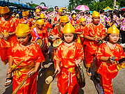 23 OCTOBER 2018 - CHONBURI, CHONBURI, THAILAND:  Thai children march in the parade before the water buffalo races in Chonburi. Contestants race water buffalo about 100 meters down a muddy straight away. The buffalo races in Chonburi first took place in 1912 for Thai King Rama VI. Now the races have evolved into a festival that marks the end of Buddhist Lent and is held on the first full moon of the 11th lunar month (either October or November). Thousands of people come to Chonburi, about 90 minutes from Bangkok, for the races and carnival midway.  PHOTO BY JACK KURTZ