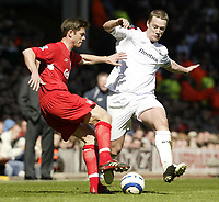 Photo: Aidan Ellis.<br /> Liverpool v Bolton Wanderers. The Barclays Premiership. 09/04/2006.<br /> Liverpool's Xabi Alonso battles with Bolton's Kevin Nolan