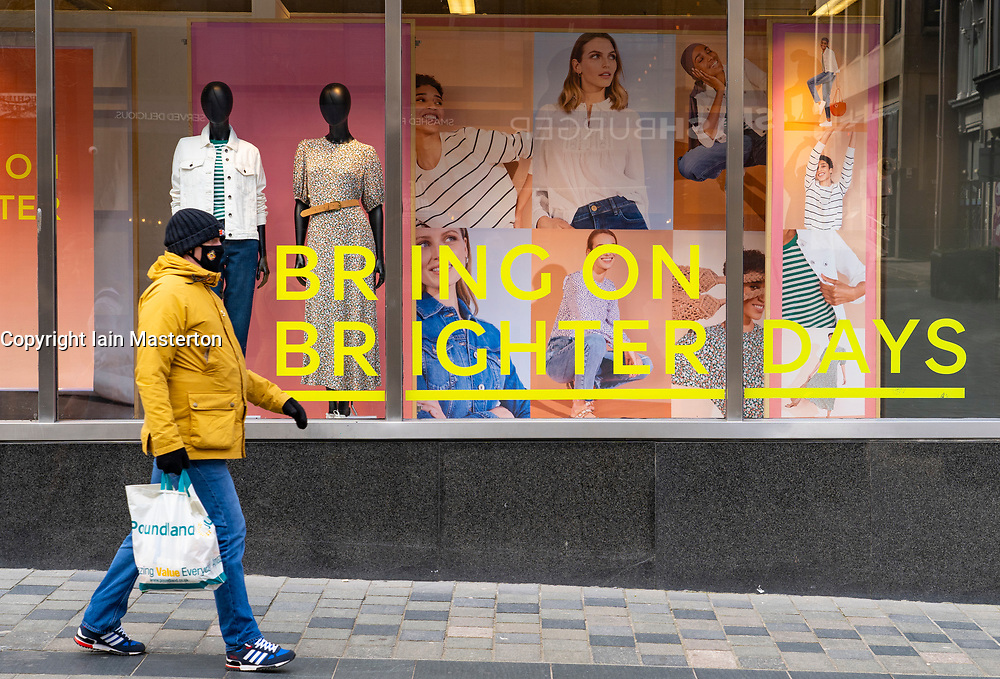 Glasgow, Scotland, UK. 23 March 2021. On the first anniversary of the coronavirus pandemic lockdown the streets in Glasgow city centre are still quiet with only essential shops open. Pic; Positive message  in shop window of M&S. Iain Masterton/Alamy Live News