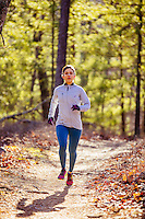 Man and woman winter trail running at Carvin's Cove outside Roanoke, Virginia, in the Blue Ridge Mountains. Women woman hiking, biking, backpacking, adventuring, camping, paddle boarding outdoors,