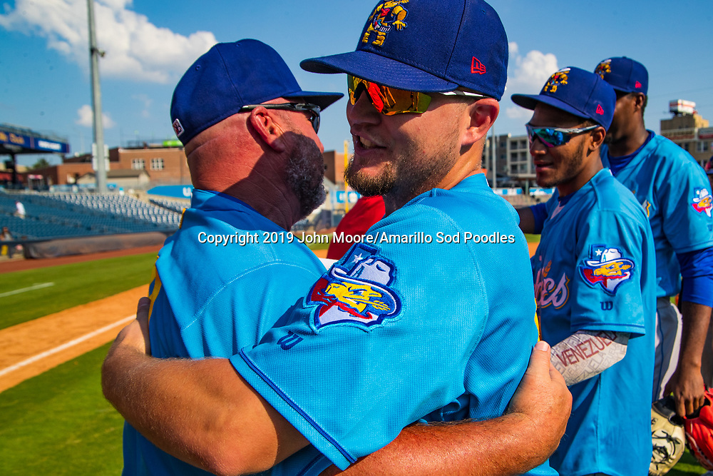 Amarillo Sod Poodles Manager Phillip Wellman and Amarillo Sod Poodles catcher A.J. Kennedy (8) celebrates after the Sod Poodles won against the Tulsa Drillers during the Texas League Championship on Sunday, Sept. 15, 2019, at OneOK Field in Tulsa, Oklahoma. [Photo by John Moore/Amarillo Sod Poodles]
