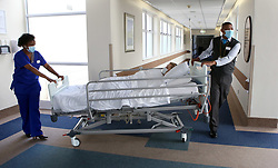 South Africa - Cape Town - 05 October 2020 - Porter Mario Angelo Williams escorting a patient. Mario Has been a porter at Mediclinic Cape Gate for five years.. Picture: Brendan Magaar/African News Agency(ANA)